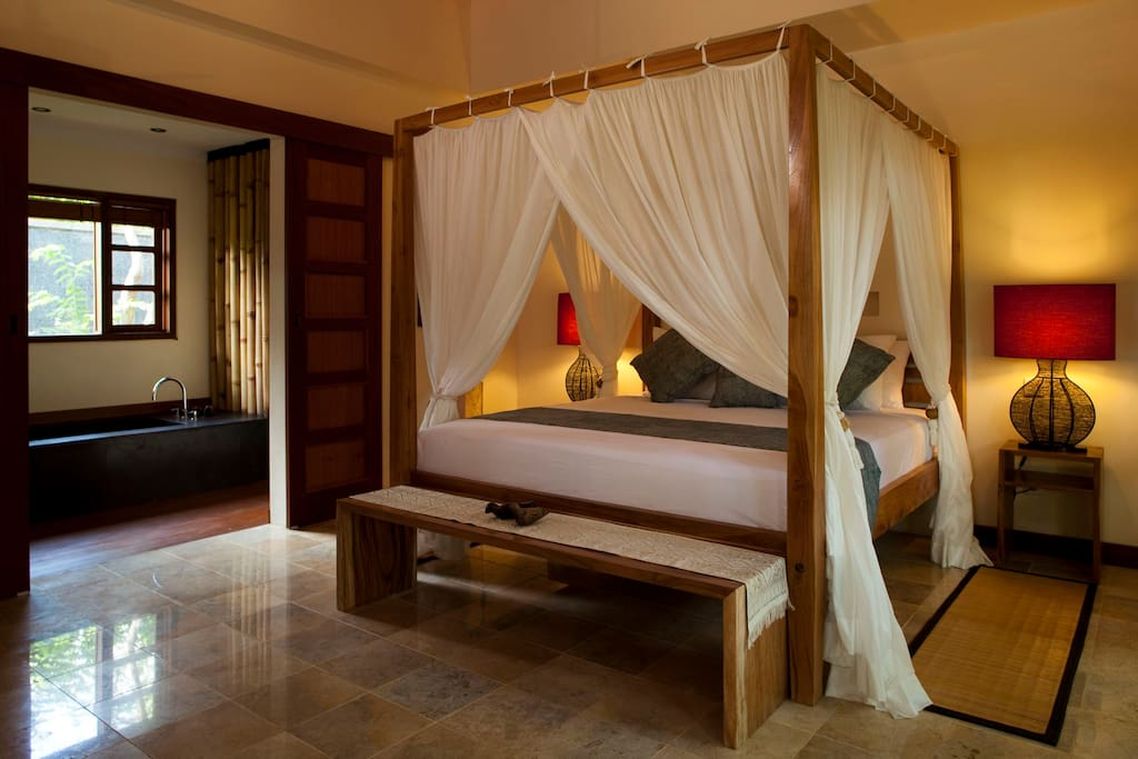 Air-conditioned Bedroom with four posted bed, mosquito net and ceiling fan