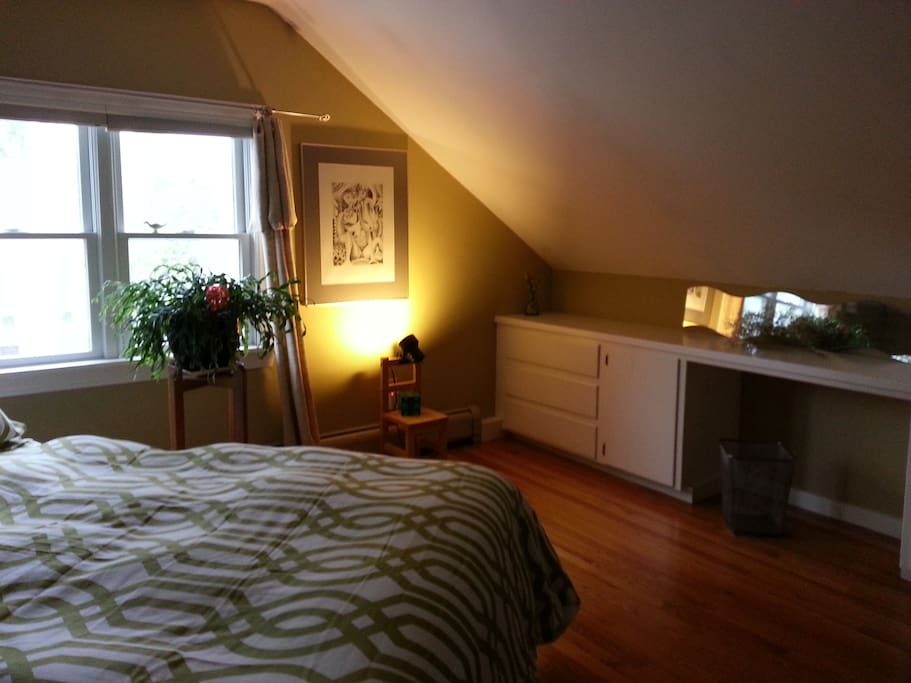 Spacious bedroom under the eaves--double bed, lots of light, and