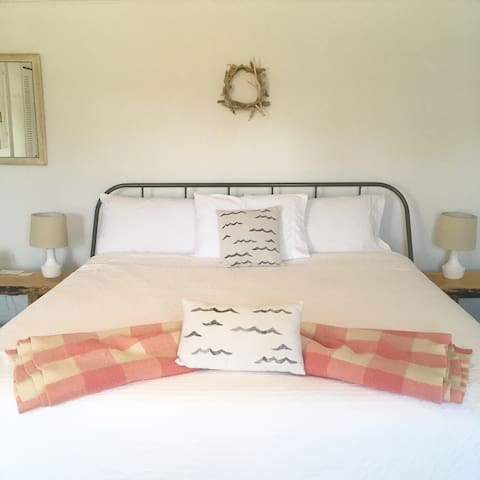 The lovely Lily Room with big, comfy king bed and cotton linens.