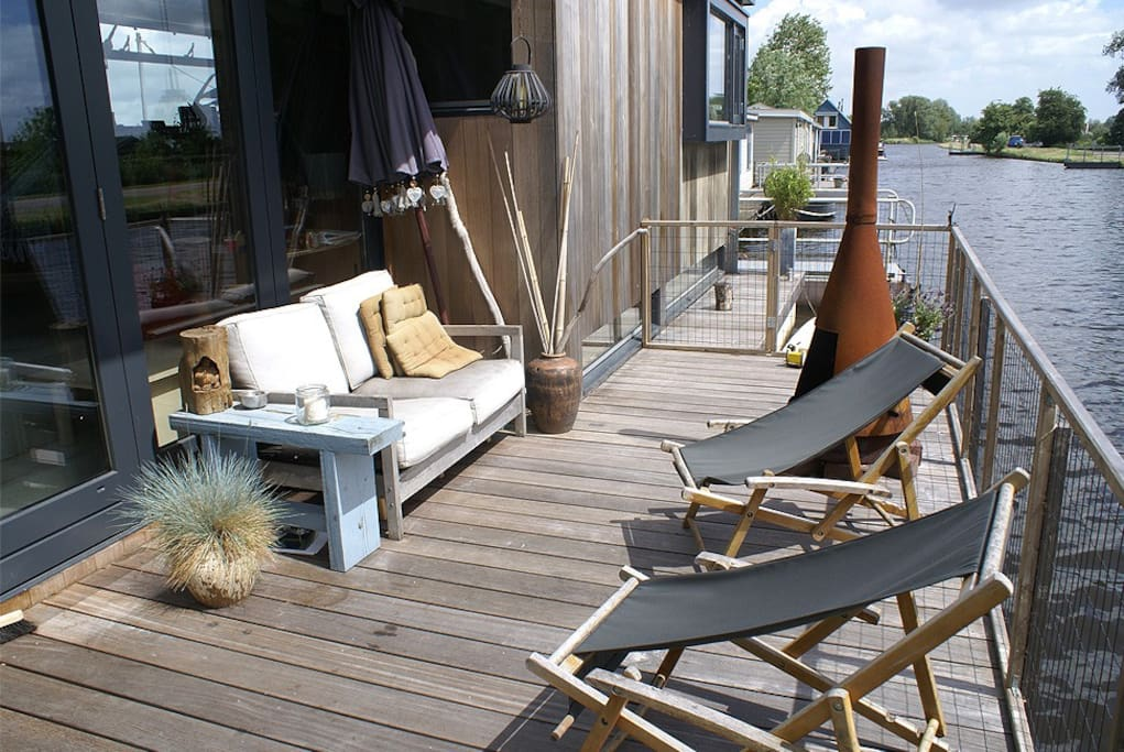 Terrace at the frontside of our houseboat, with sunchairs and fireplace for chilly nights.