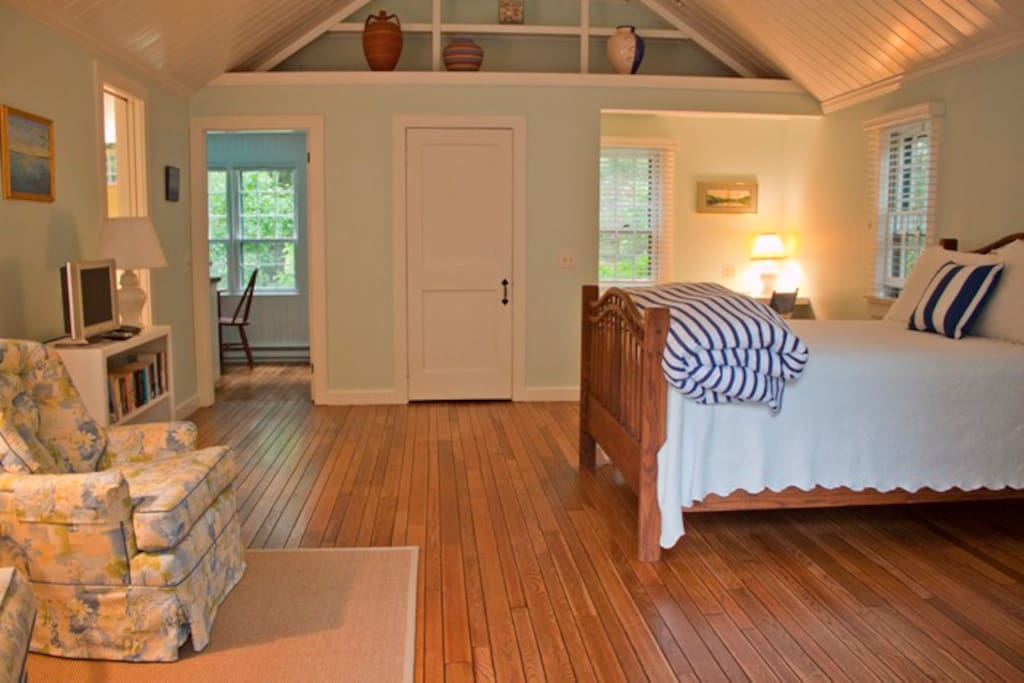 Looking from french doors into apartment- newly refinished hardwood floors, airy, cool and clean!