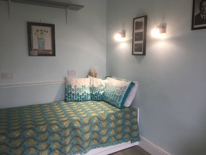 Comfortable bedrooms in a quiet period home