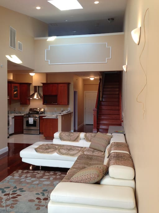 Living room with Kitchen, white Door is the enterance and stair to go upstair Penthouse and roof top Deck