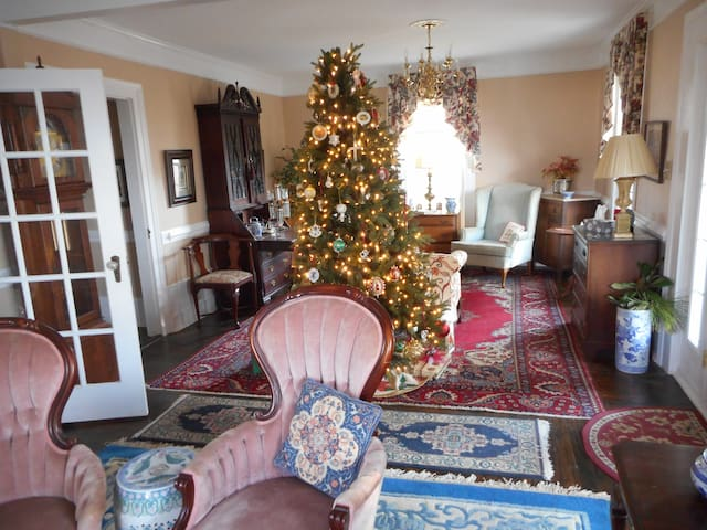 Downstairs there is a large Den and Parlor combination with a TV, a large writing desk, 4 wing chairs, and 2 sofas.
