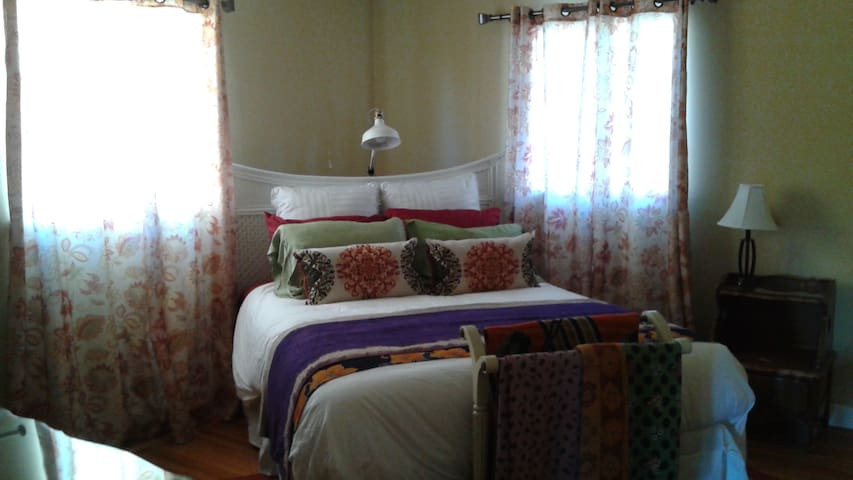 Brand new queen size bed, mattress, luxury linens, duvet, pillows, unisex robes; reading area; large bureau and clothing rack with storage