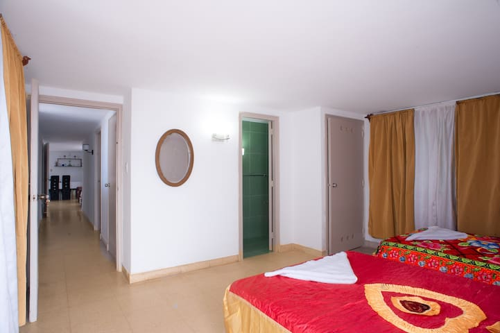 Heated room with independent bathroom, also with access to one of the terraces and two comfortable beds