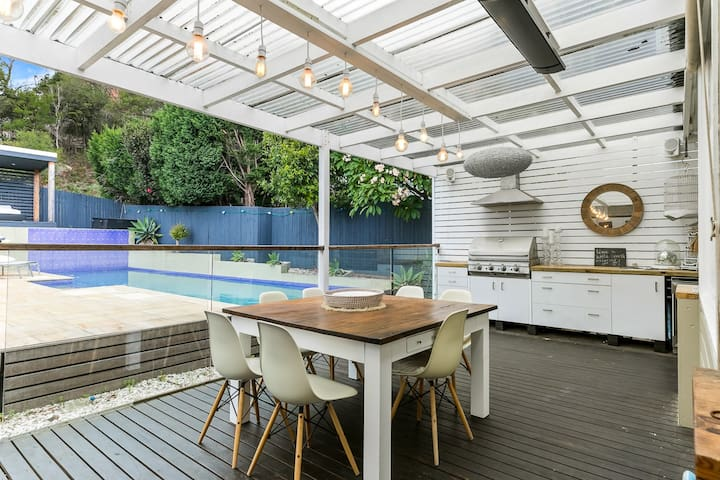 The large entertaining deck overlooking a sparkling 12 metre pool