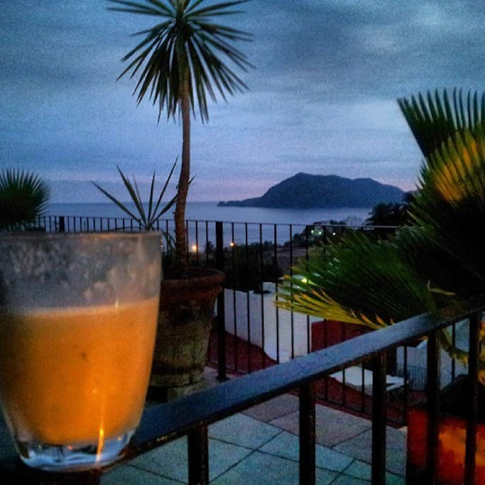 Night View of Boquita bay from the palapa with a Guanabana  (cheremoya) smoothie with Hava club Rum