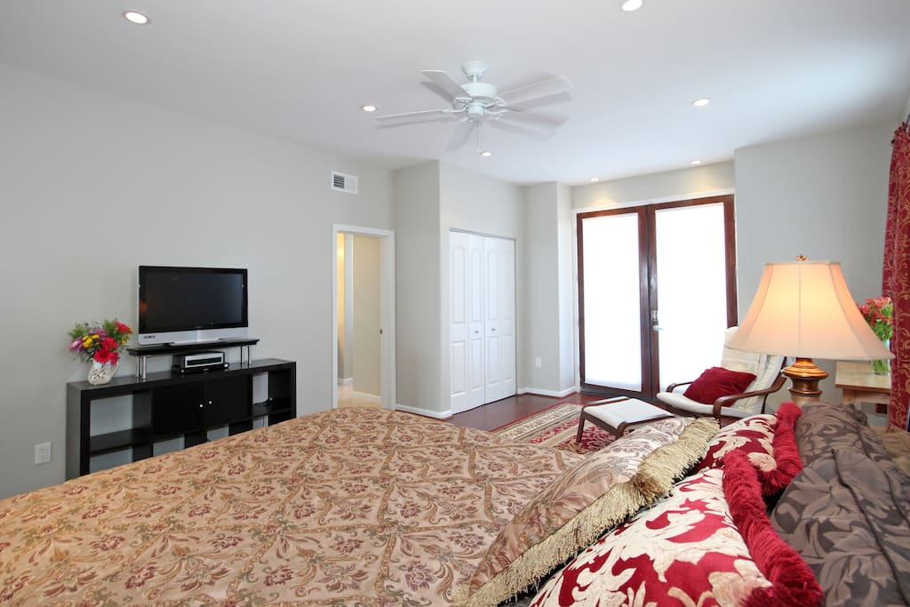 The master bedroom is furnished with a comfy king sized bed, TV, mini fridge, microwave, coffee maker and complimentary drinks.