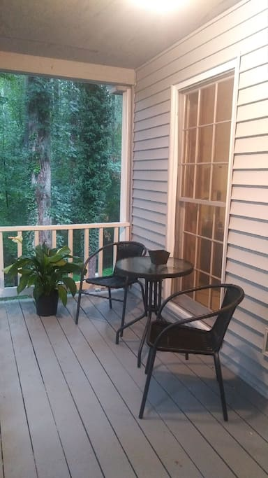 Seating for two to enjoy your veiw outside wrap around deck/porch area.