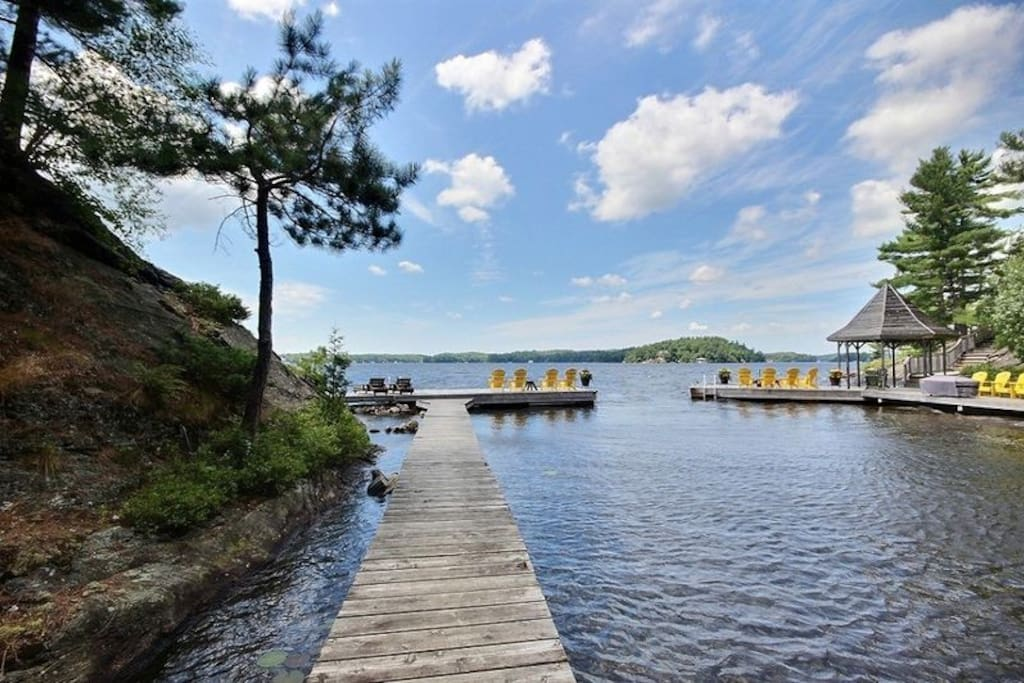 Run way to private dock. Sheltered swim area in cove - shared with neighboring cottage