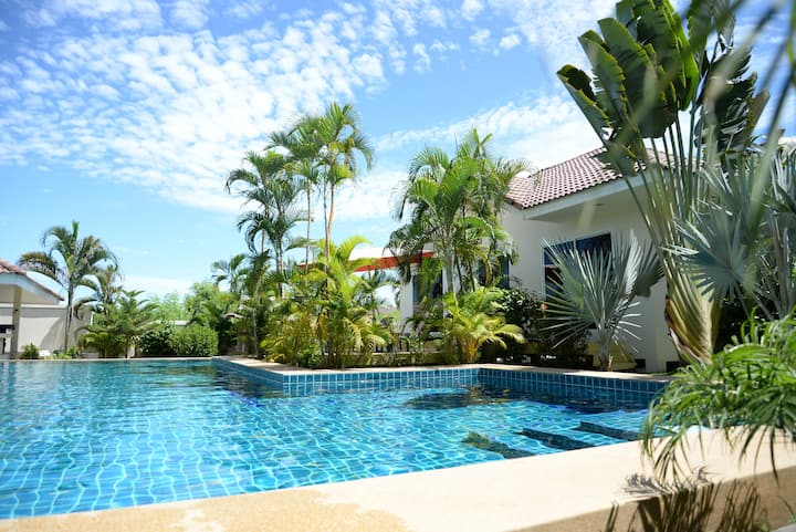 Poolside villa with large deck area