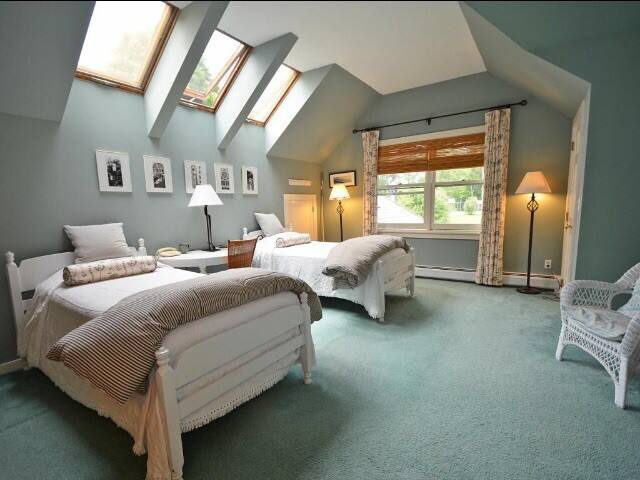 Bedroom with two singles and 1 queen sized bed