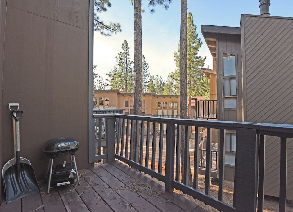 Upstairs back deck with a BBQ.