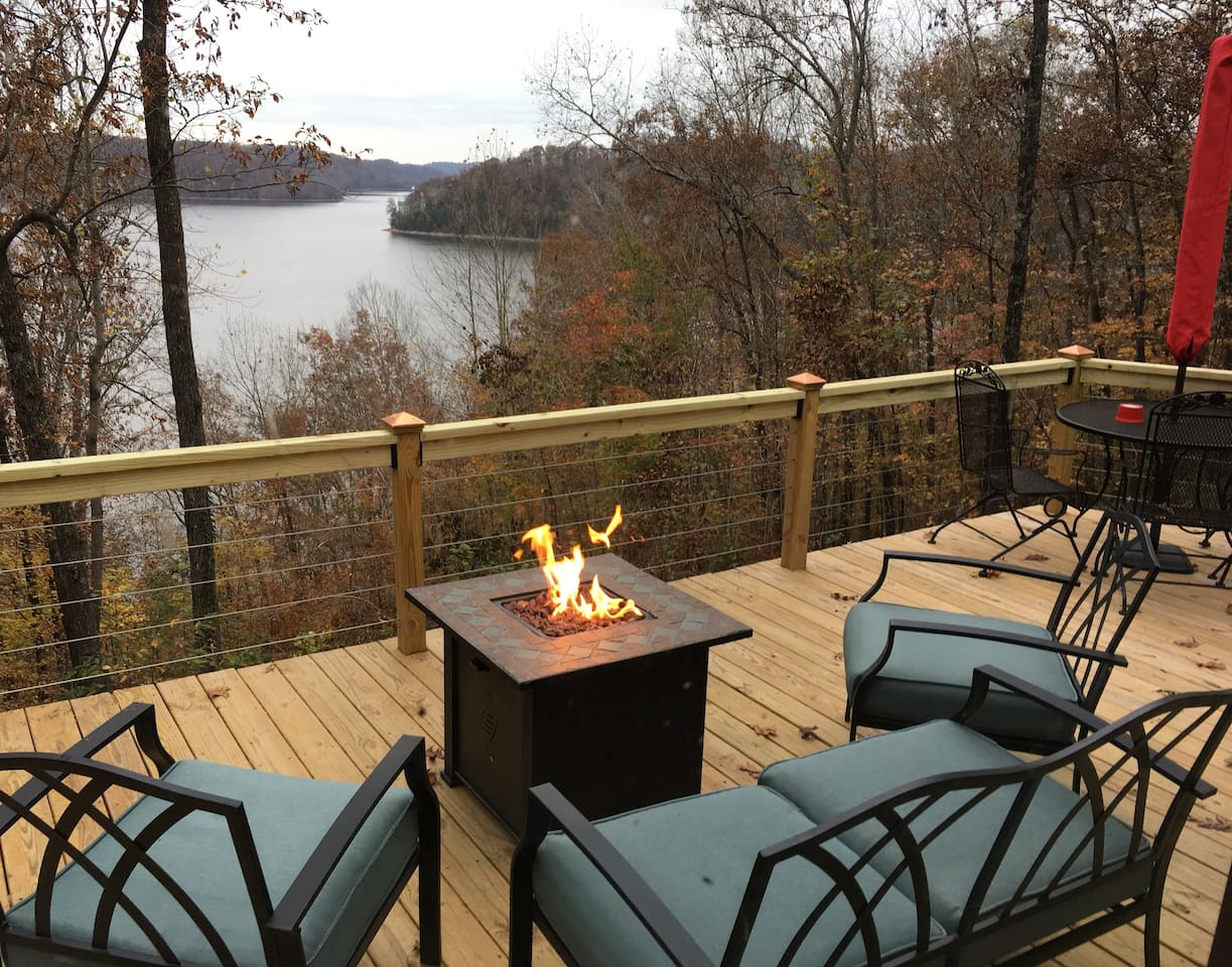 Deck with fire pit overlooking lake to the west