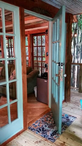 Our hefty antique oak entry door is from a 120- year old house that  used to belong to the Mayor of Atlanta.  Note the beautiful antique wavy glass in the treehouse lites.