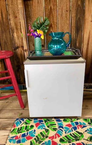 Mini fridge keeps your refreshments chilled and easily accessible.