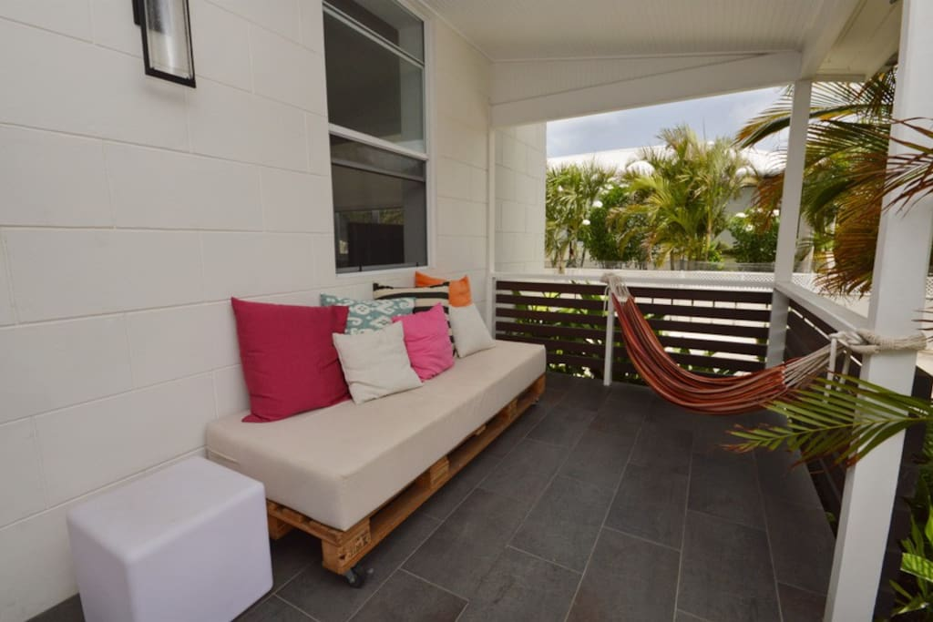 Front Porch : Lounging area with couch and hammock