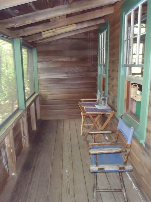 Screened porch faces Long Pond