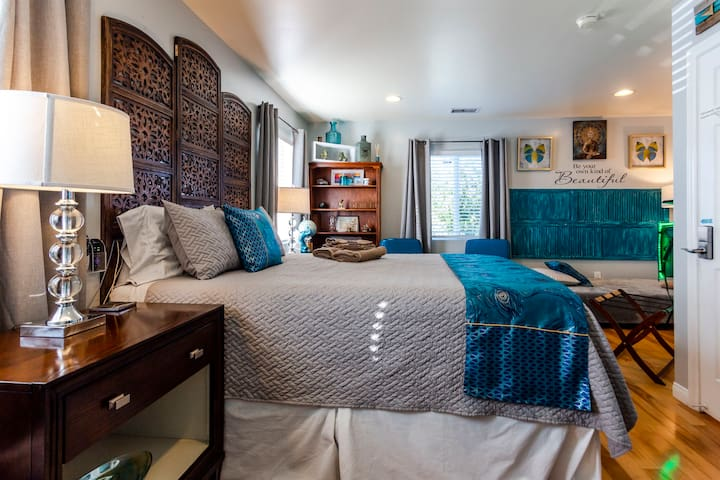 Master suite in teal @Ty's w pool.