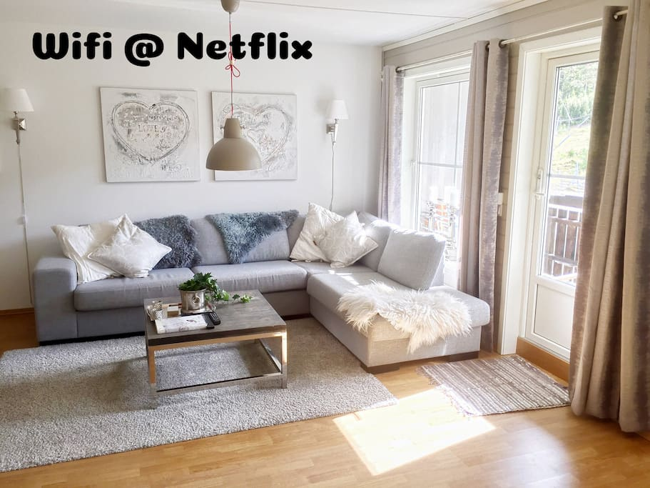 Light living room with comfortable sofa with delicious pillows. Views of the mountains and the slalom slopes. A modern fireplace provides a wonderful atmosphere in the evenings.  You may use high speed WIFI and view movies on Netflix/TV2Sumo. There are also Nordic channels available.