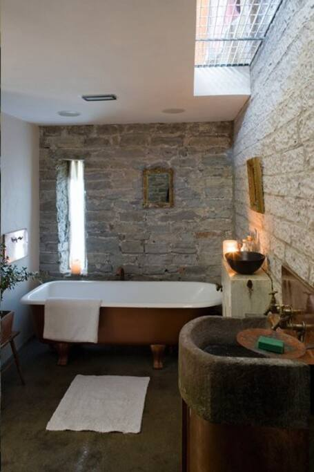 ensuite bathroom & wet room stone walls polished concrete floor