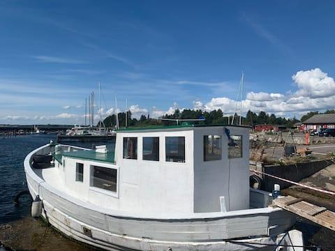 Old fishingboat at beautiful Hårbølle Havn