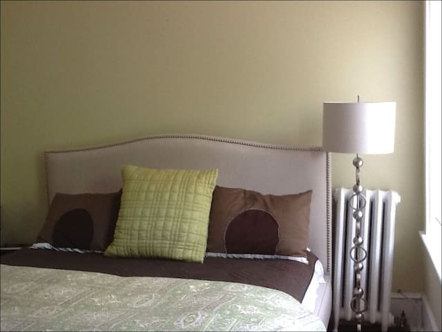 Hotel-grade Nature's Rest bed with luxurious headboard