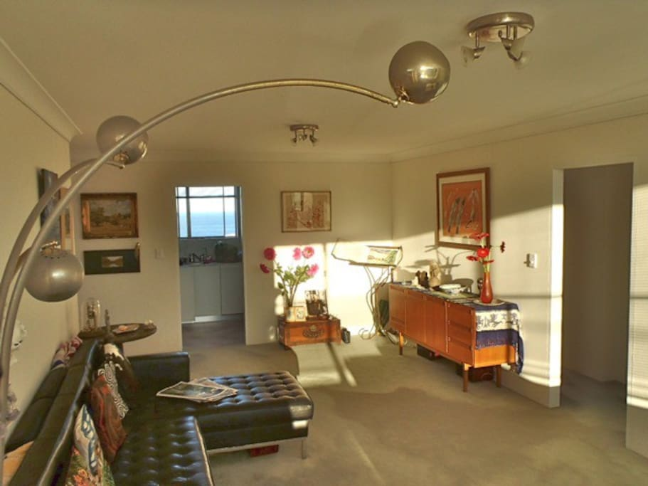 The living room, looking towards the kitchen and the sea.