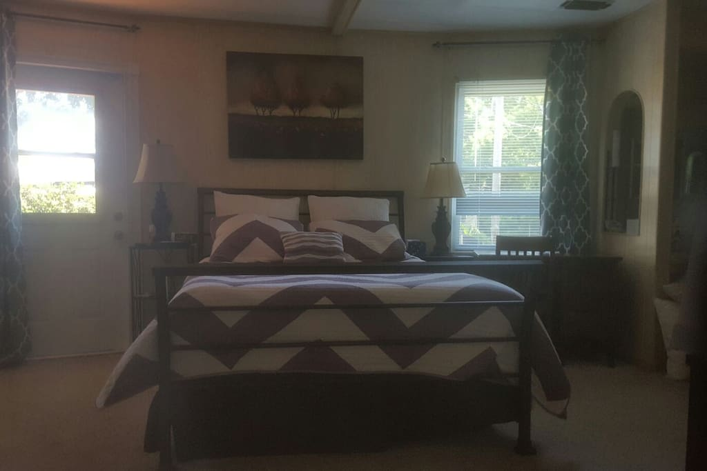 Suite with queen size bed, access door to back yard deck.
