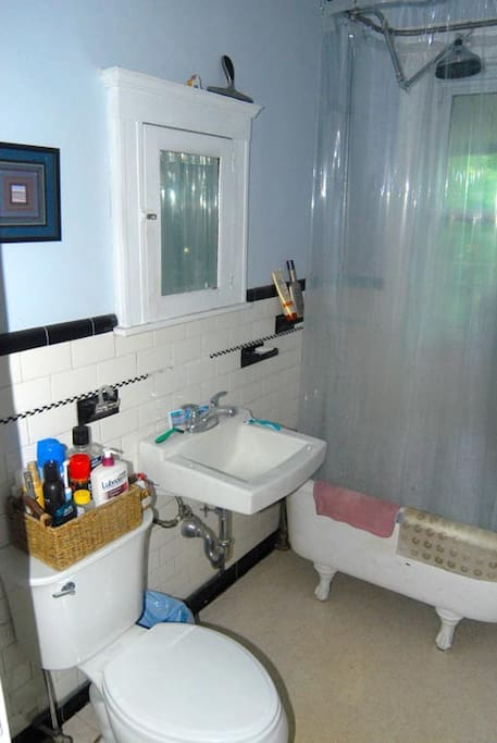 Bathroom has shower/tub.