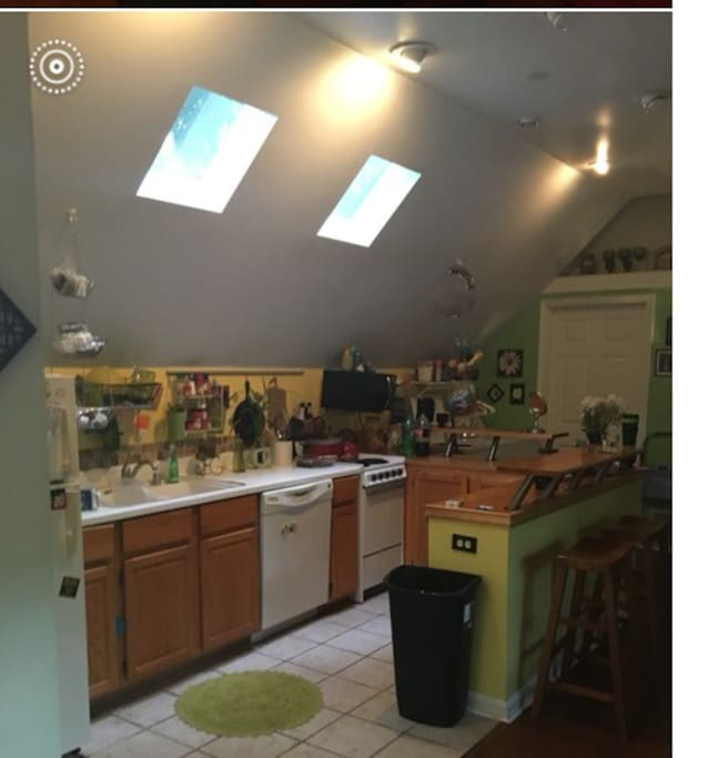 Small kitchen, with custom eat at bar, and gorgeous skylights