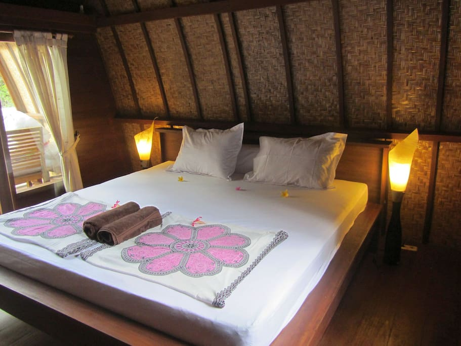 this is your room - very stylish with a super kingsize bed, lovely deco, wardrobe and aircon,wooden floor,all natural materials