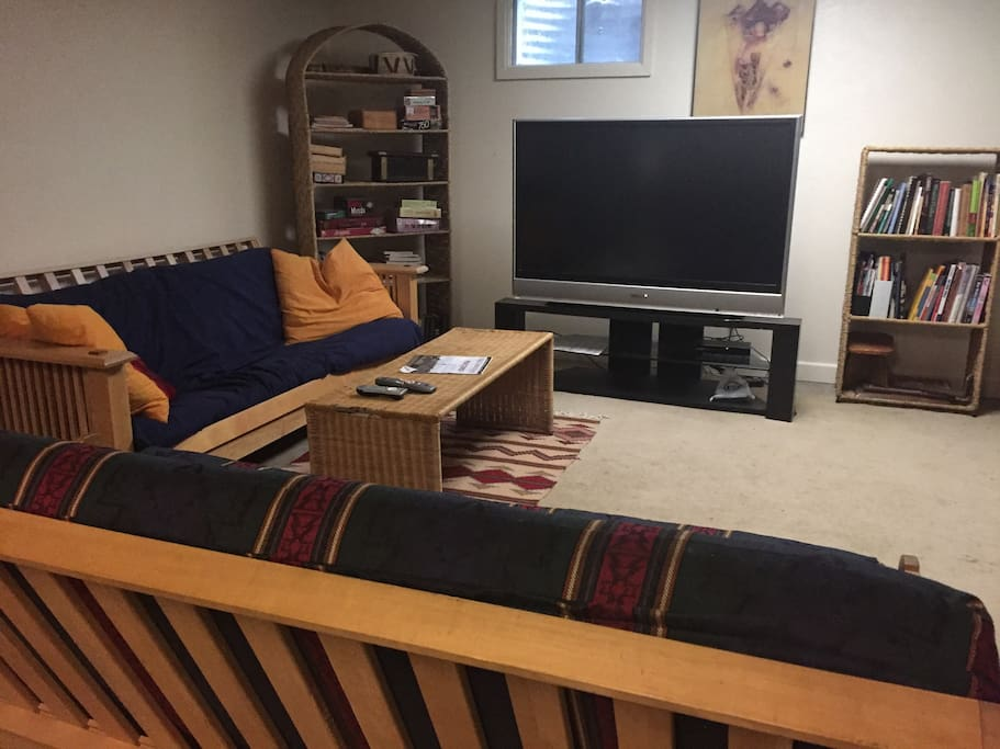 Huge HD TV and living room with two futons. Extra Guests are $25 per night.