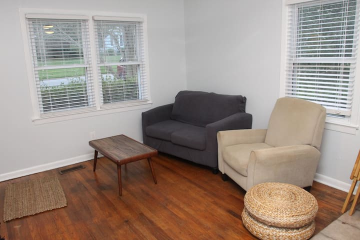 Come in, and relax in this cozy living room, complete with a recliner and TV (which is wall-mounted opposite the recliner).