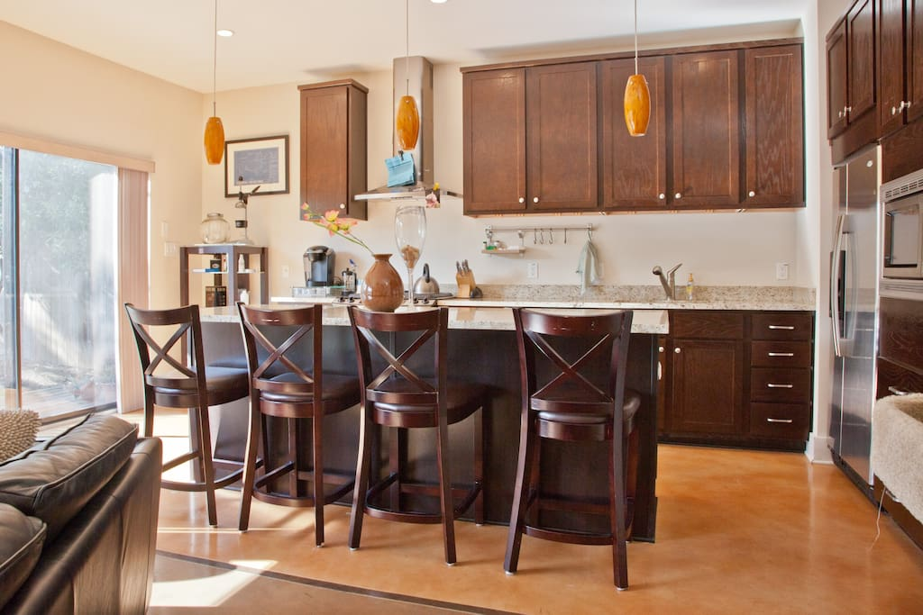 Clean and expansive kitchen, plenty of space to cook and eat.