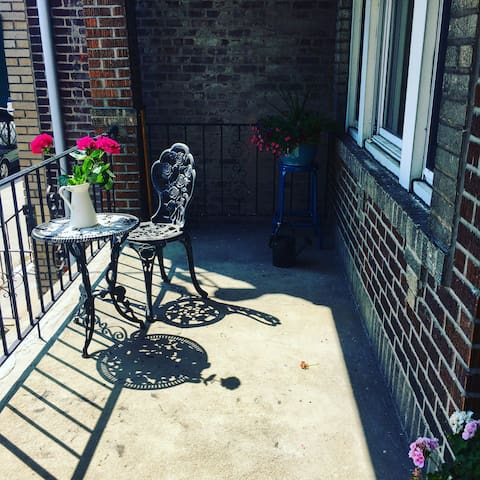 Admire the view of the NYC skyline while  enjoying morning coffee on this adorable front porch!