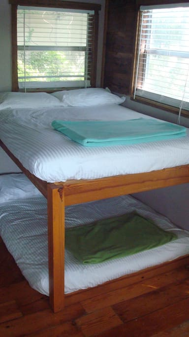 Plush futons made up with line dried sheets in the Rustic Oak Cabin.
