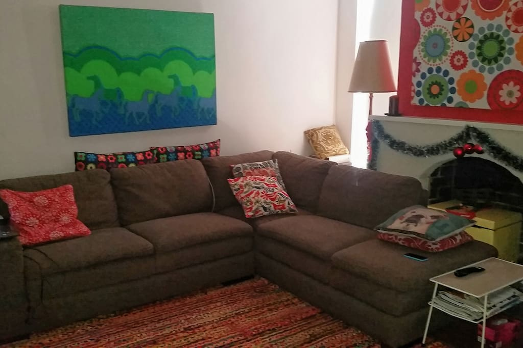 Comfy and colourful lounge room with DVD player and stereo.