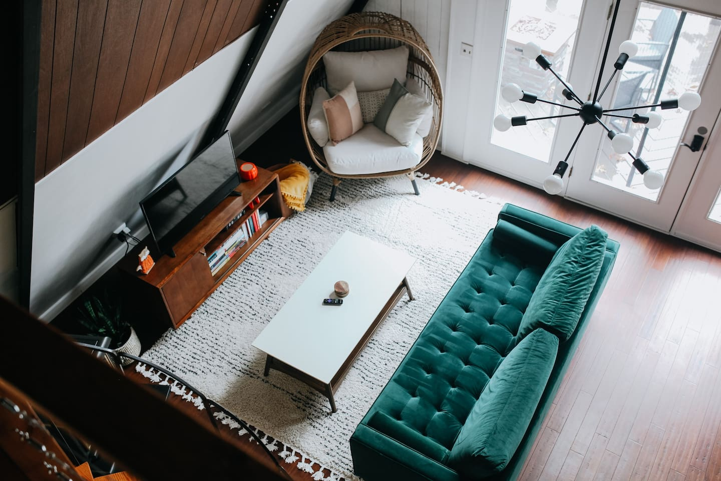 """Open living space with comfortable mid-century modern seating, smart tv, and more.   """"I loved the location, it was breathtaking. There were books to read, games to play, and Netflix available if you wanted to have a night in"""""""