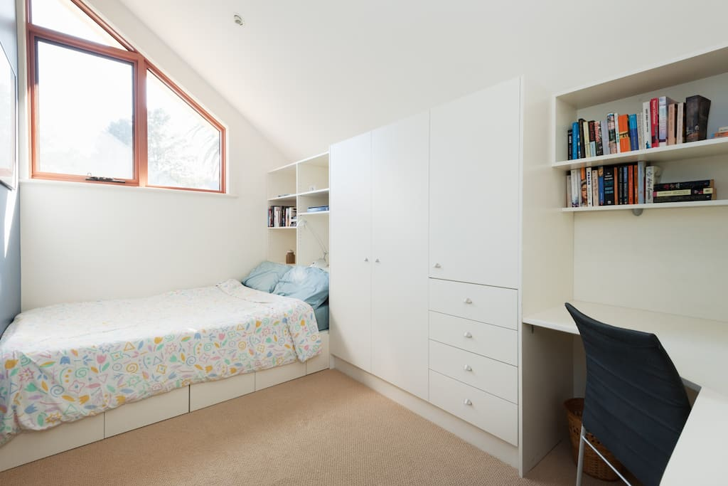 De-stress in your sunny upstairs double bedroom with aircon., built-in cupboards and desk