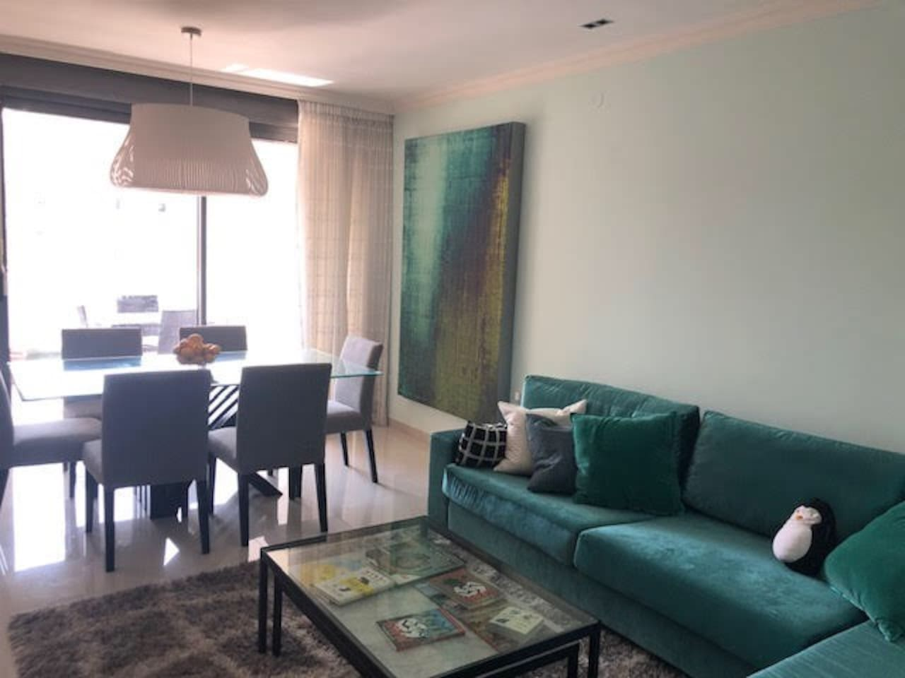 Living room, dining area, balcony