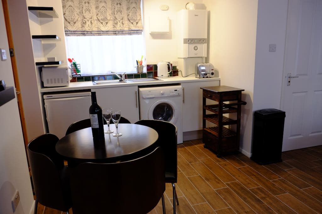 Kitchenette with microwave, washer/dryer and fridge
