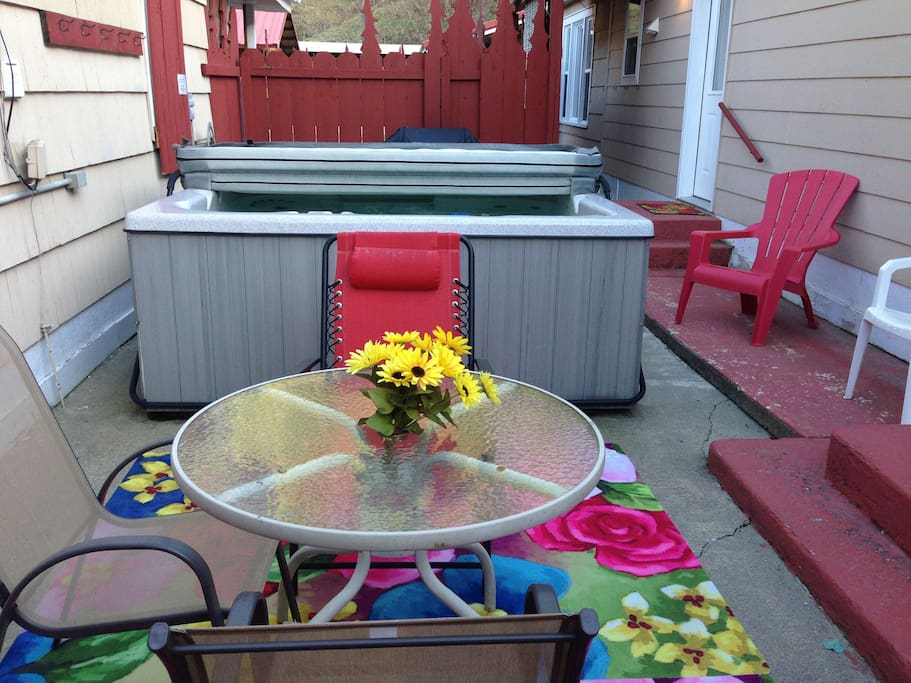 Sunny patio with hot tub and gas BBQ