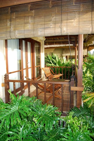 Each bungalow has it's own private balcony overlooking the rice fields