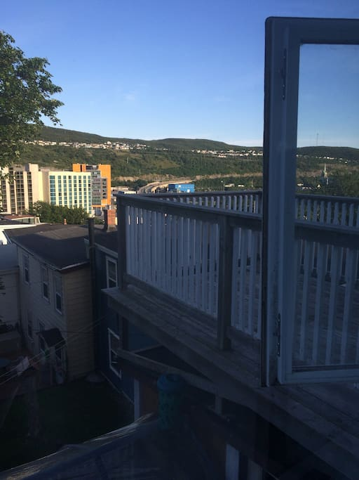View from the bedroom window over looking the private deck and downtown St. John's