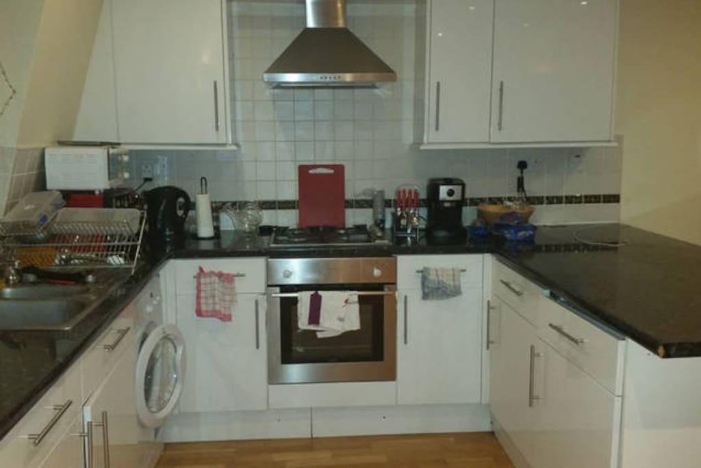 Fully equipped kitchen with oven, microwave, gas hob, fridge, freezer, dish washer, washing machine, etc...