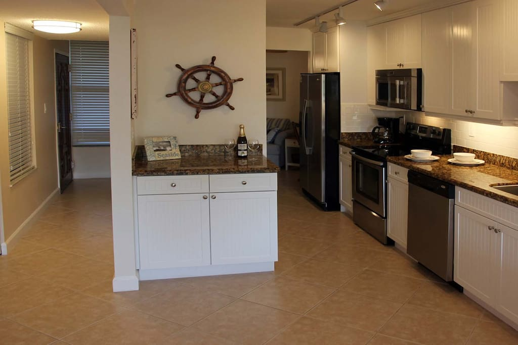 Well stocked kitchen with stainless steel appliances