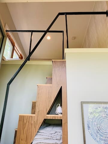 Walnut Stairs to loft bedroom with storage underneath.   *Please not the rise of the stairs is steep.  Additional bed downstairs if you prefer not to go to the loft.