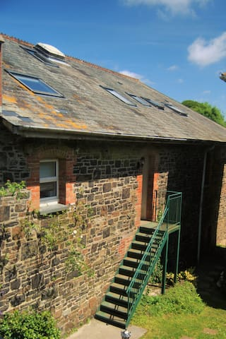 Beautiful traditional Victorian granite building with slate roof.